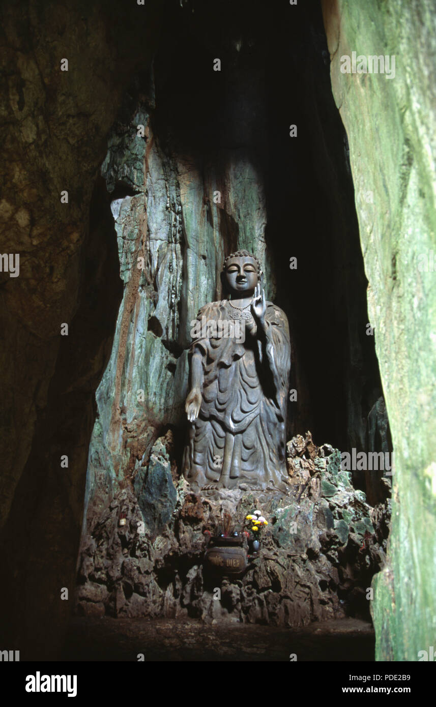 Close-up of Buddha in cave in the Marble Mountains in Thoy Son, near Danang in Vietnam - Stock Image