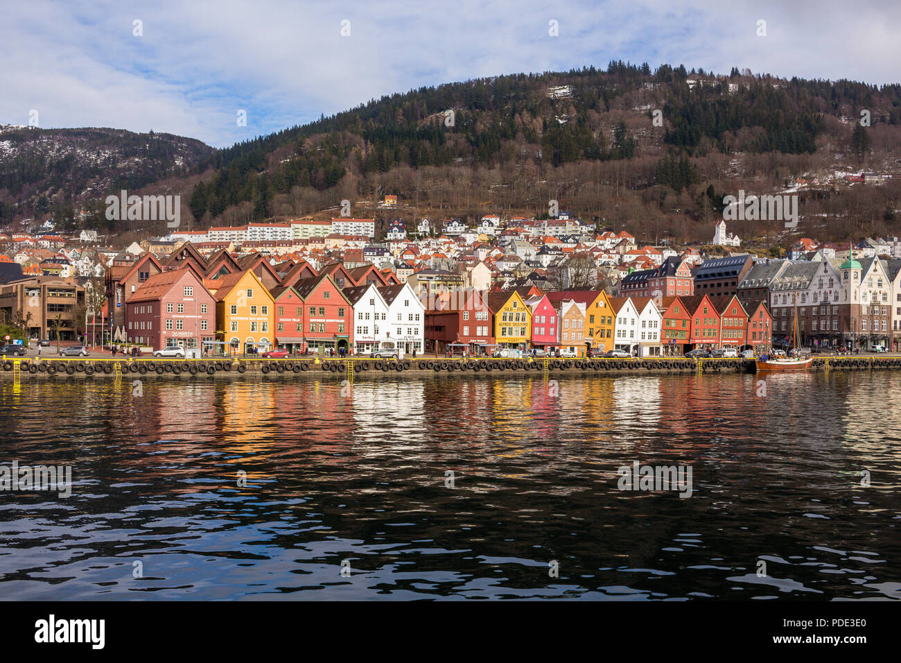 Bryggen, Bergen, Norway taken from a boat in the harbour in the morning. Stock Photo