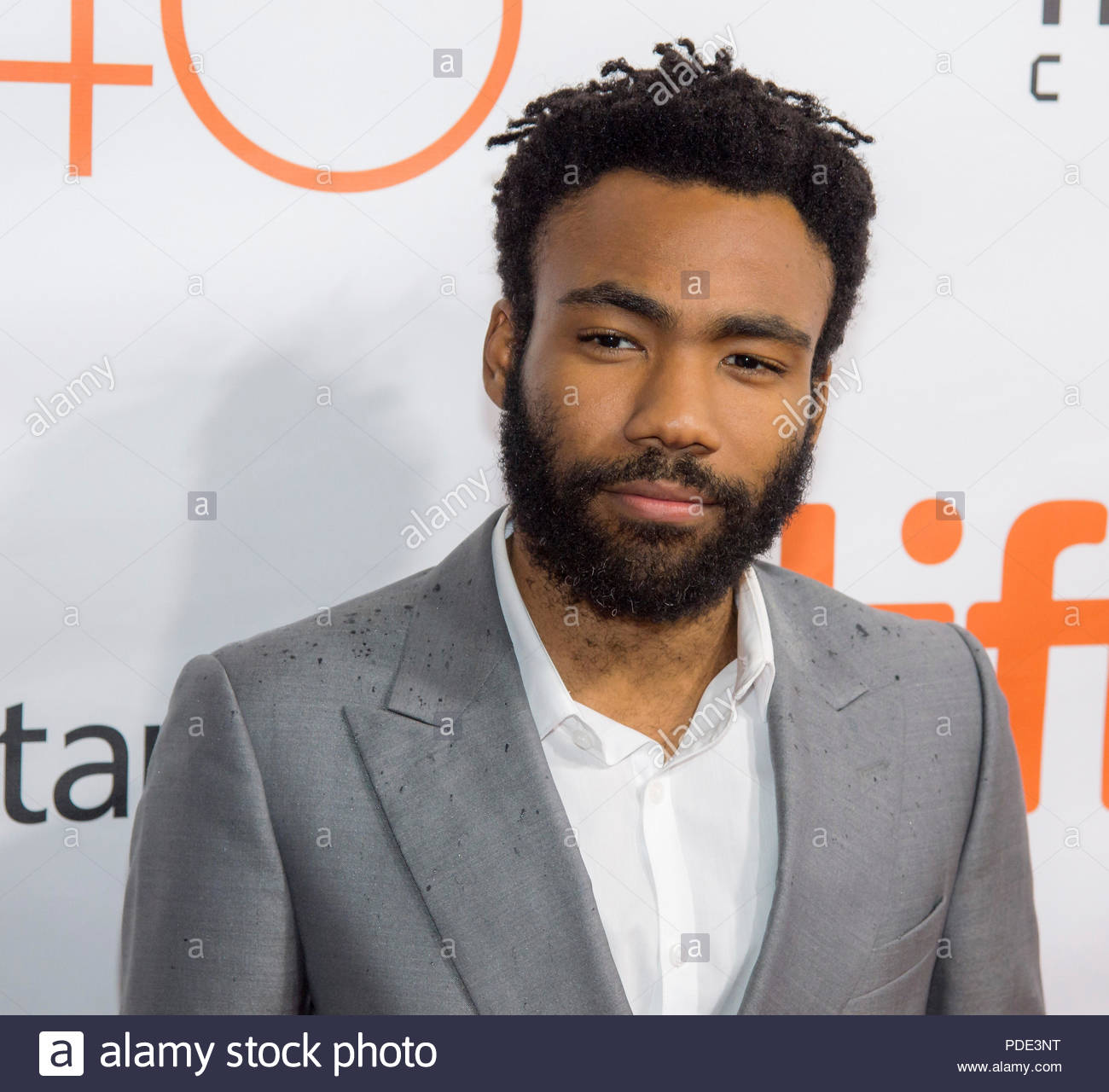 """CANADA Toronto -- 11 Sep 2015 -- Actor Donald Glover attends the world premiere for 'The Martian"""" on day two of the Toronto International Film Festival at the Roy Thomson Hall, Friday, Sept. 11, 2015 in Toronto. NASA scientists and engineers served as technical consultants on the film. The movie portrays a realistic view of the climate and topography of Mars, based on NASA data, and some of the challenges NASA faces as we prepare for human exploration of the Red Planet in the 2030s -- Picture by Bill Ingalls/Atlas Photo Archive/NASA - Stock Image"""