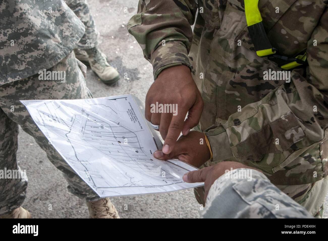 Members of the Hawaii National Guard review a map in response to a volcano outbreak May 12, 2018, at Leilani Estates, Pahoa, Hawaii. More than 100 soldiers and airmen have been activated to form Task Force Hawaii, which is assisting government agencies by providing presence patrols in affected and traffic guidance in affected neighborhoods. - Stock Image