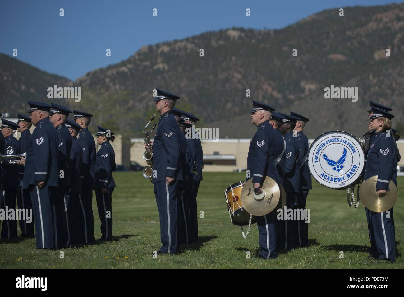The U S  Air Force Academy Band stands at attention moments