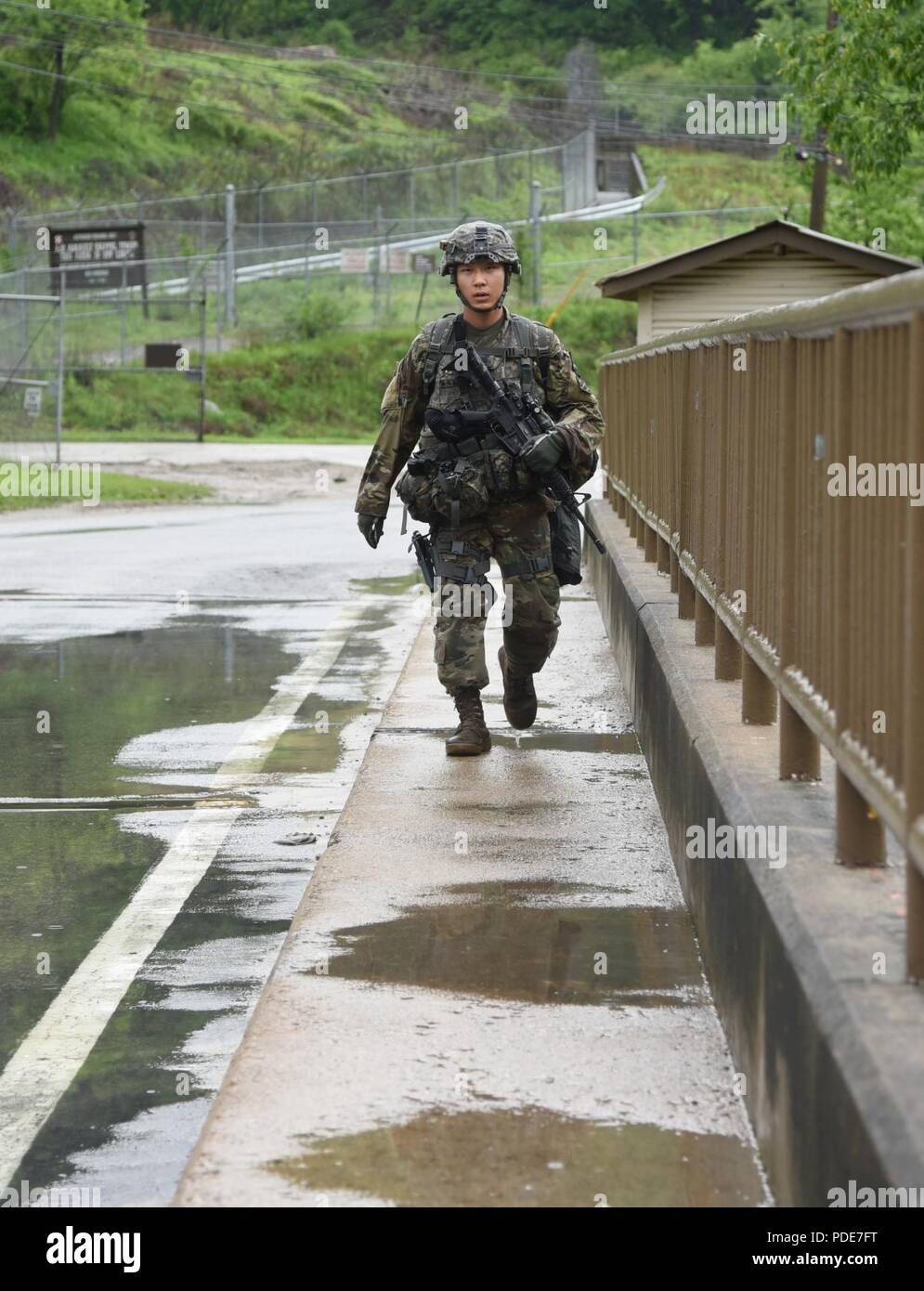 Cpl. Song, Tae Hoon, a native of Seoul, South Korea, assigned to 1st Armored Brigade Combat Team, 3rd Infantry Division, supporting the 2nd Infantry Division as part of the rotational forces, moves to his next point at the day stakes challenge during the Eighth Army 2018 Best Warrior Competition, held at Camp Casey, Republic of Korea, May 17. The Eighth Army BWC is being held to recognize and select the most qualified junior enlisted and non-commissioned officer to represent Eighth Army at the U.S. Army Pacific Best Warrior Competition at Schofield Barracks, HI, in June. The competition will a Stock Photo