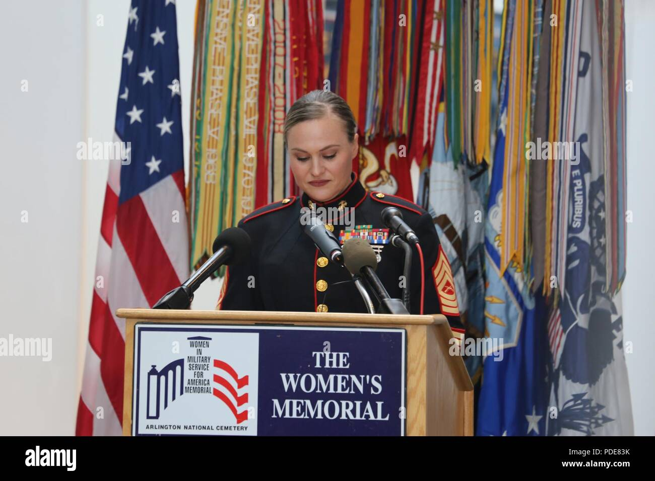 Master Sgt. Meghann Viggiani delivers a speech on behalf of the five servicewomen recognized at the Women in the Military Wreath Laying Ceremony, sponsored by the Congressional Caucus for Women's Issues, Arlington, Virginia, May 17, 2018. Viggiani, recognized for her courage and professional achievements, is the logistics chief at Marine Barracks Washington, and was the Marine Corps' outstanding senior female noncommissioned officer at the event. The annual ceremony, which was held at the Women in Military Service for America Memorial, honors women across all branches of military services. - Stock Image
