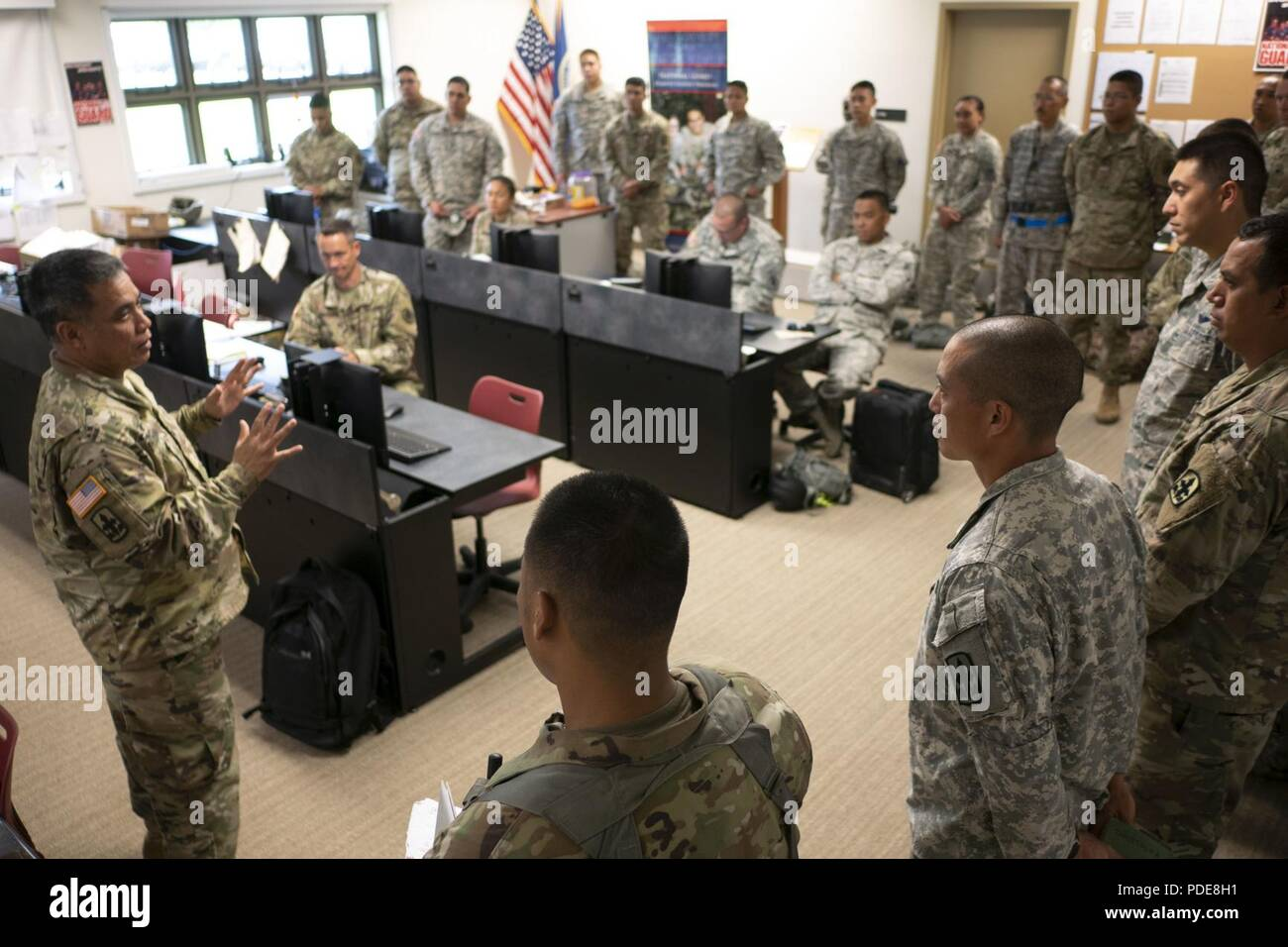 Lt. Col. Shawn Tsuha, Task Force Hawaii commander, addresses his growing team of guardsmen May 16, 2018, at the Joint Operations Center, Hilo, Hawaii. The unit is working alongside with civilian and active duty counterparts under the command of Joint Task Force 5-0 in response to the ongoing volcanic activity on Hawaii Island. - Stock Image