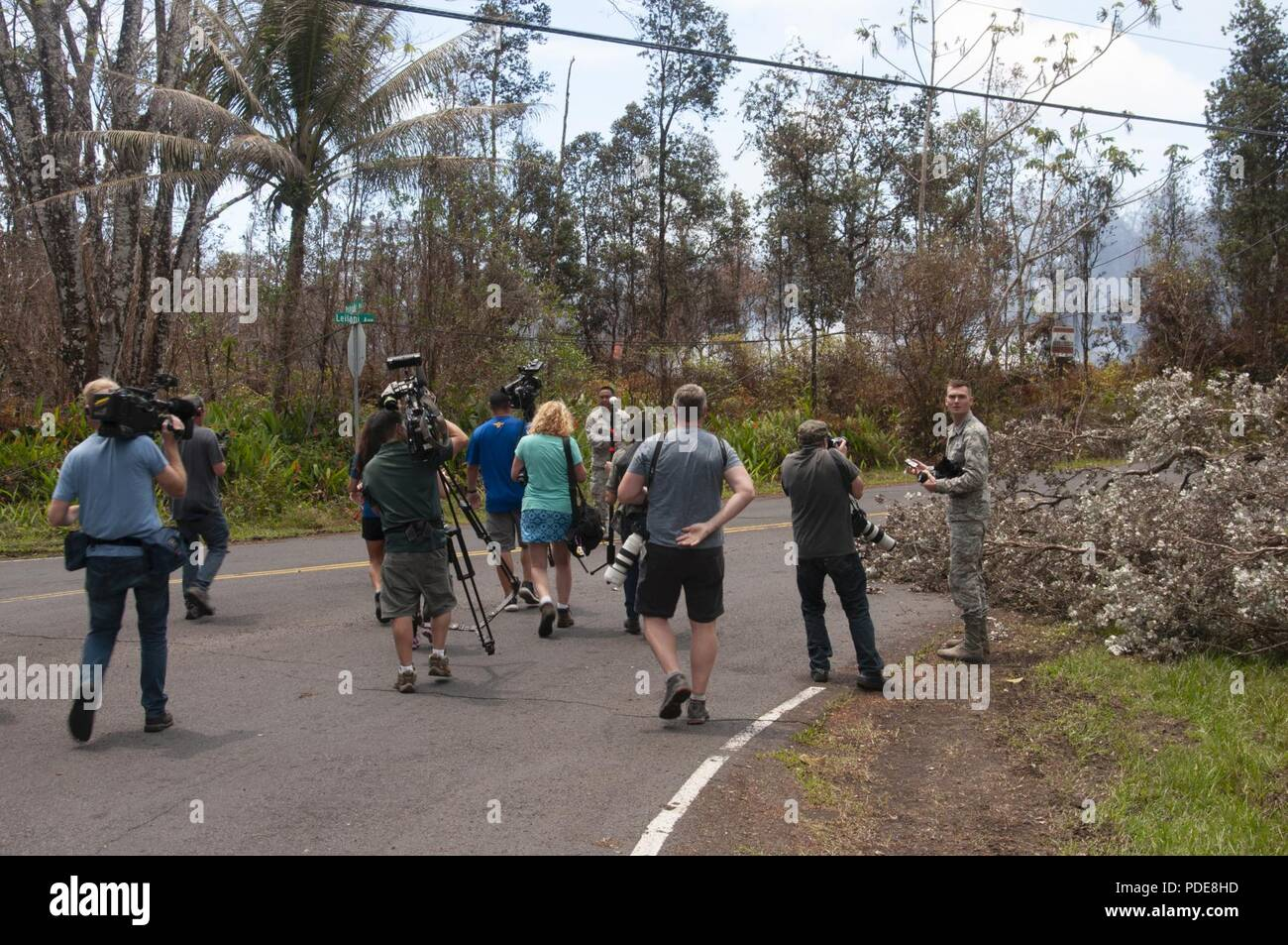Task Force Hawaii National Guardsmen, escort news media through Leilani Estates May 16, 2018, on Hawaii Island. Reporters from local and national media outlets were escorted by the task force through damaged residential areas after the eruption of Kilauea volcano. - Stock Image