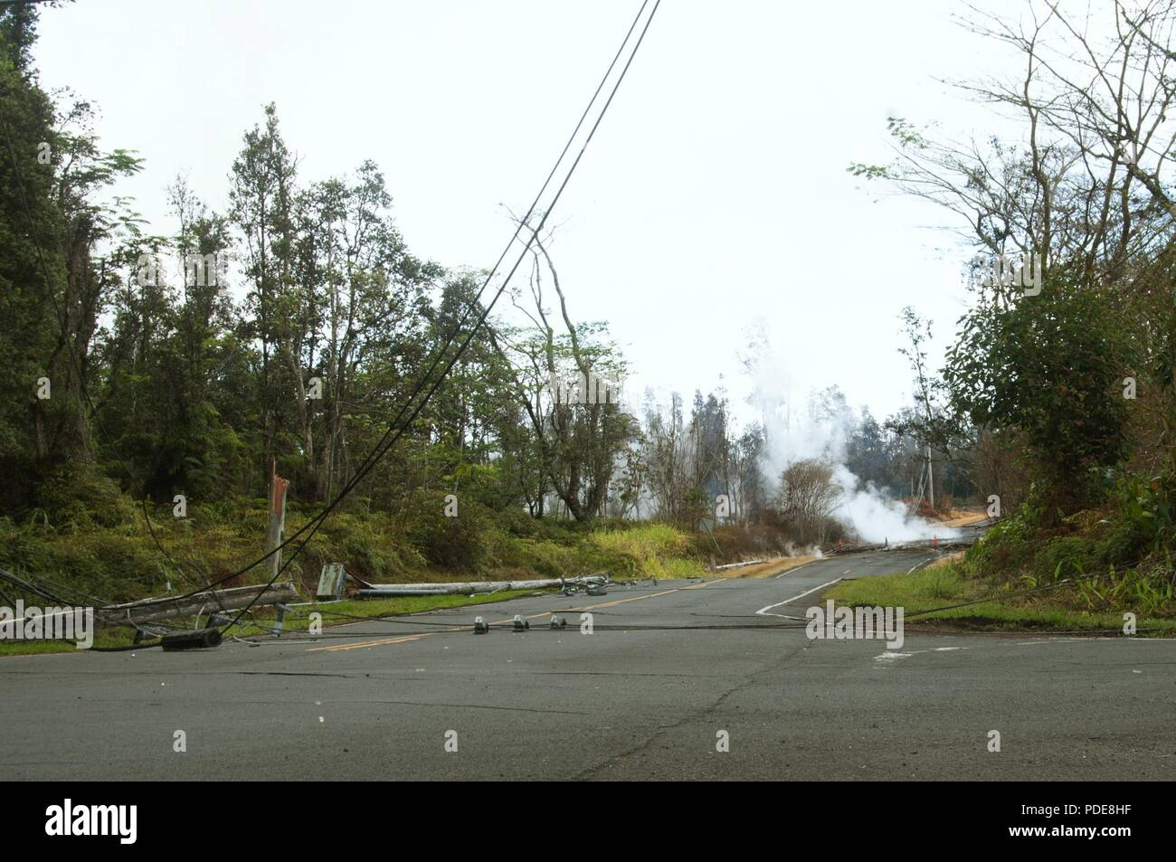 Damaged telephone lines littered residential roads in Leilani estates May 16, 2018, on Hawaii Island. The telephone lines had fallen after they suffered damage during volcanic activity on the island. - Stock Image