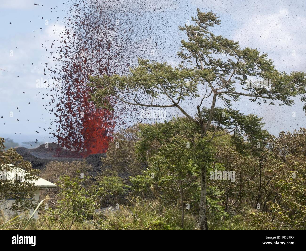 A 17th lava fissure erupts hundreds of feet in the air during a volcano outbreak May 18, 2018, Pahoa, Hawaii. In response to the ongoing outbreak, more than 100 members of the Hawaii National Guard have been called upon to assist Hawaii County agencies as part of an operation called Task Force Hawaii. - Stock Image