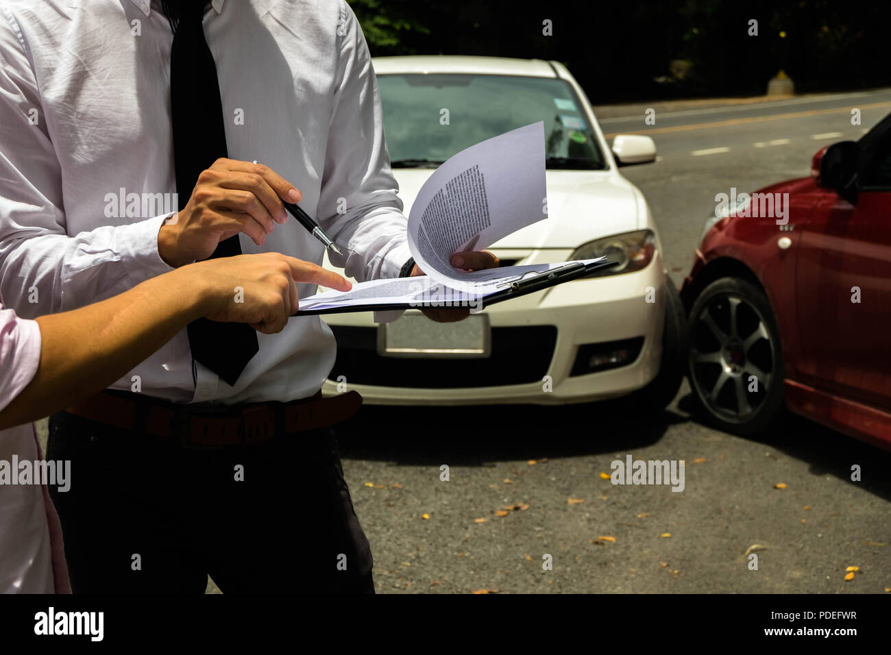 The insurance agent working claim process in payment on from parties .Insurance claim concept . - Stock Image