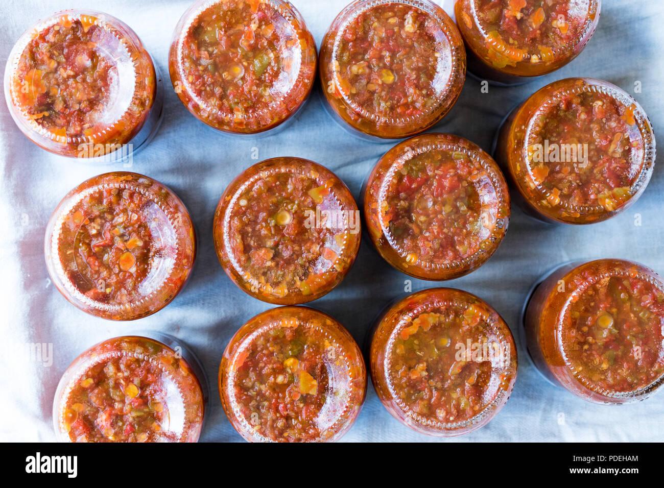 Homemade Preserved Tomato Paste Sauce in Glass Jar. Organic Food. Stock Photo