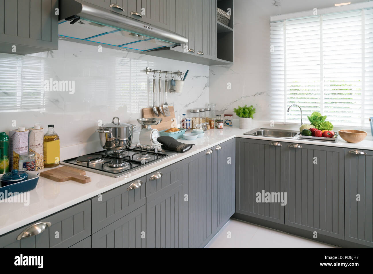 Kitchen Wood Utensils Chef Accessories Hanging Copper Kitchen With White Tiles Wall Stock Photo Alamy