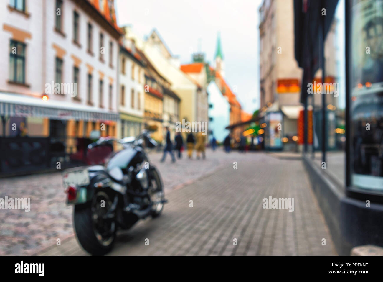 Motorcycle On Bruschatoy Street Of The Old Town In Riga Close To Cafes And Shops Blurry Stock Photo Alamy