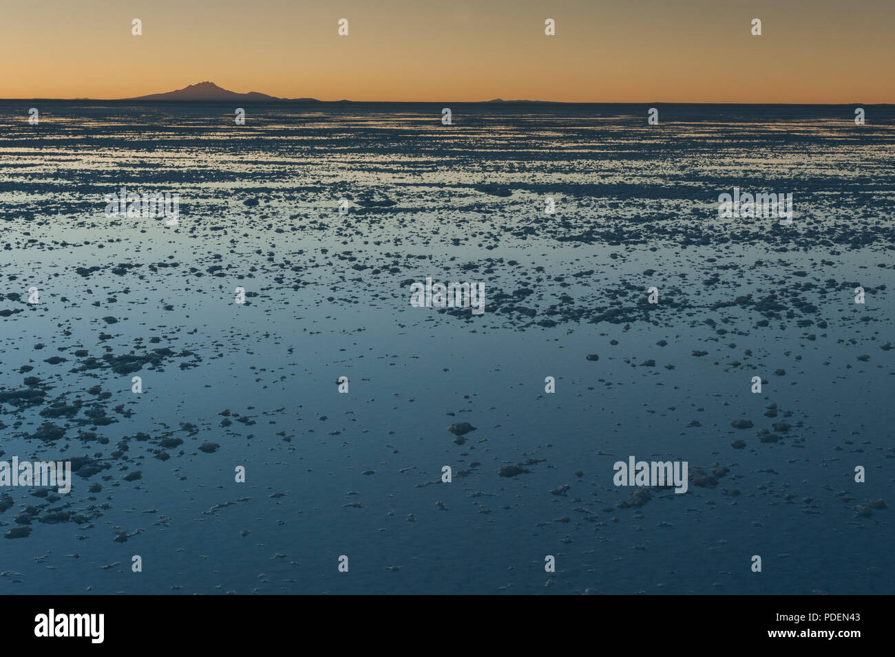 Sunset in the Salar de Uyuni, near Colchani. It is the largest salt flat in the World UNESCO World Heritage Site - Altiplano, Bolivia - Stock Image