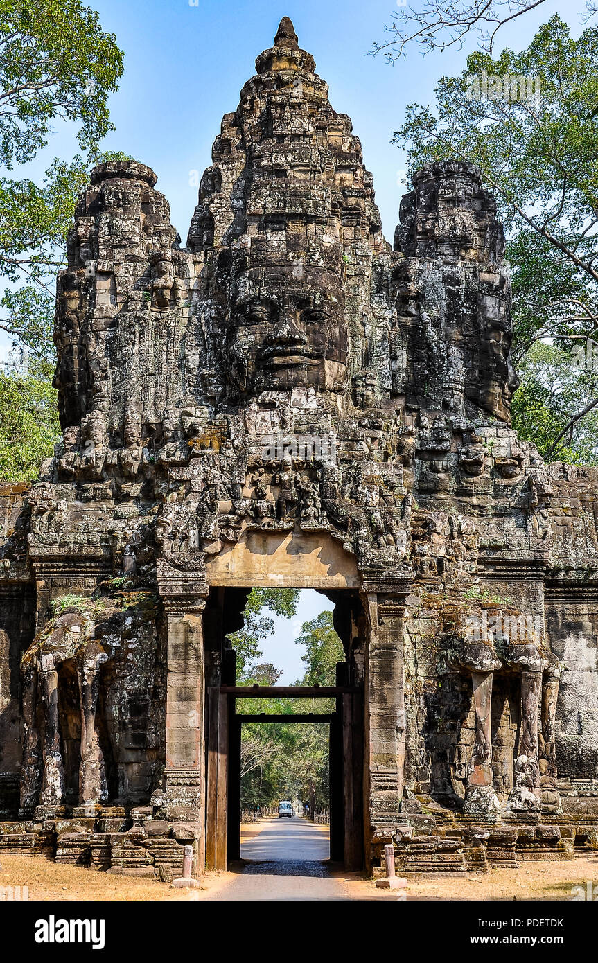 Gate with relief in the ruins of Angkor Wat, Cambodia - Stock Image
