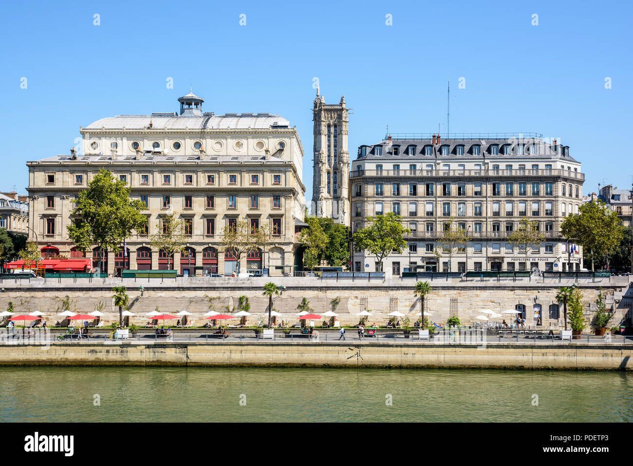 The banks of the Seine during Paris-Plages summer event with the Chatelet theater on the left and the Saint-Jacques tower in the background. - Stock Image