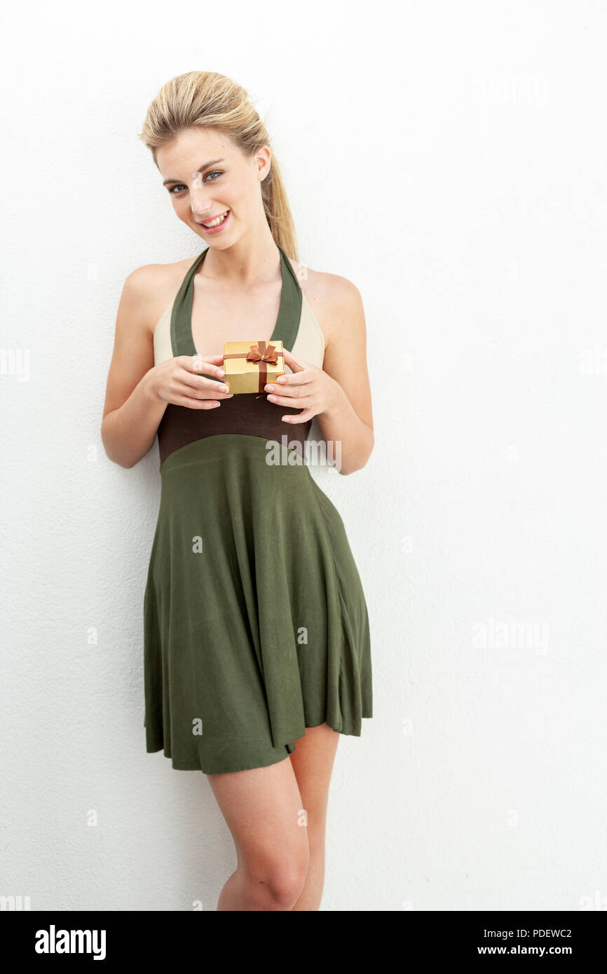 Young woman holding a gift box Stock Photo