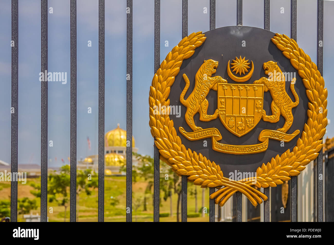 Malaysia, Kuala Lumpur - August 16, 2013:  Royal seal on the gate of the new Istana Negara, which is the royal residence of the Yang di-Pertuan Agong  - Stock Image