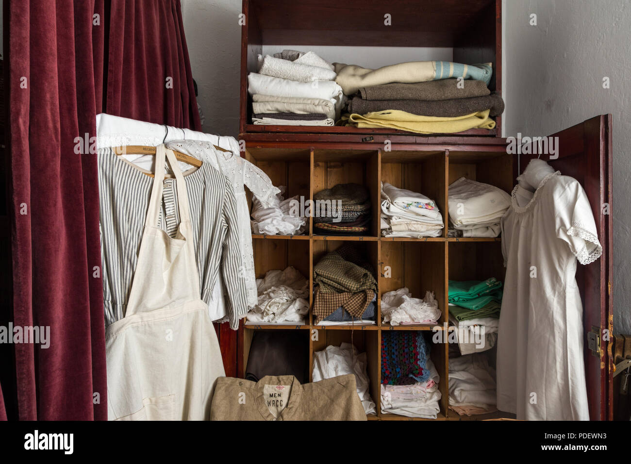 Linen cupboard with typical bedding and clothing from the ...