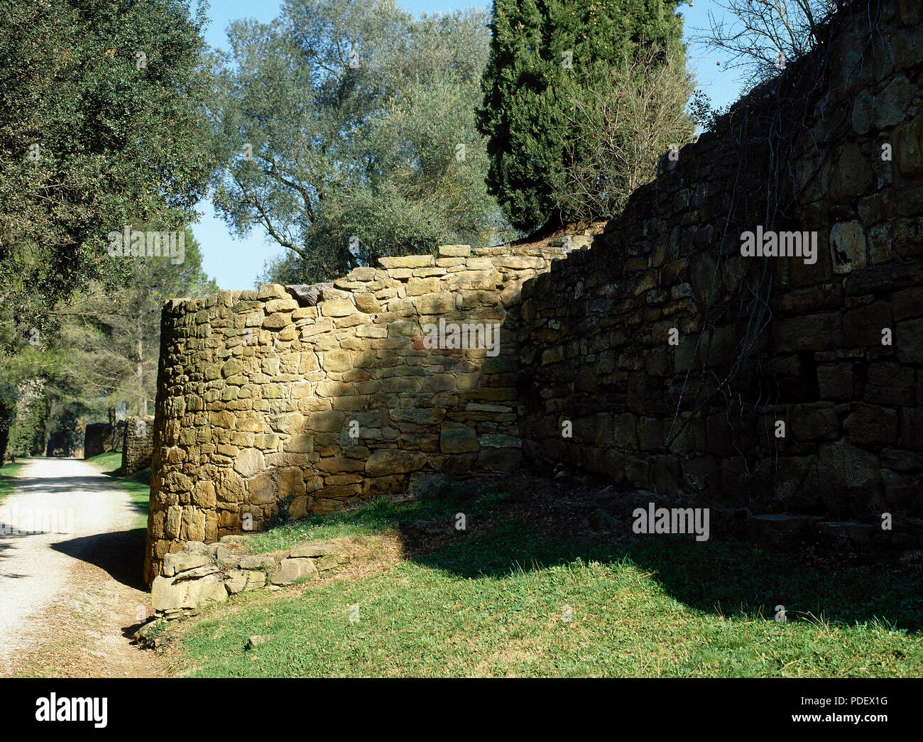 Iberian settlement of El Puig de Sant Andreu. 6th century-2nd century BC. Iberian-Roman wall. Circular tower belonging to the oldest fortification (late 6th century-early 5th century BC). Ullastret. Girona province. Catalonia. Spain. - Stock Image