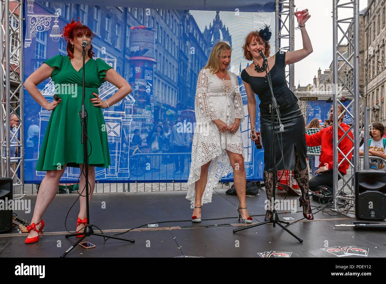 Till Death do us Part group of three ladies performs atThe Edinburgh Festival Fringe 2018 in High Street The Royal Mile Edinburgh Scotland UK - Stock Image