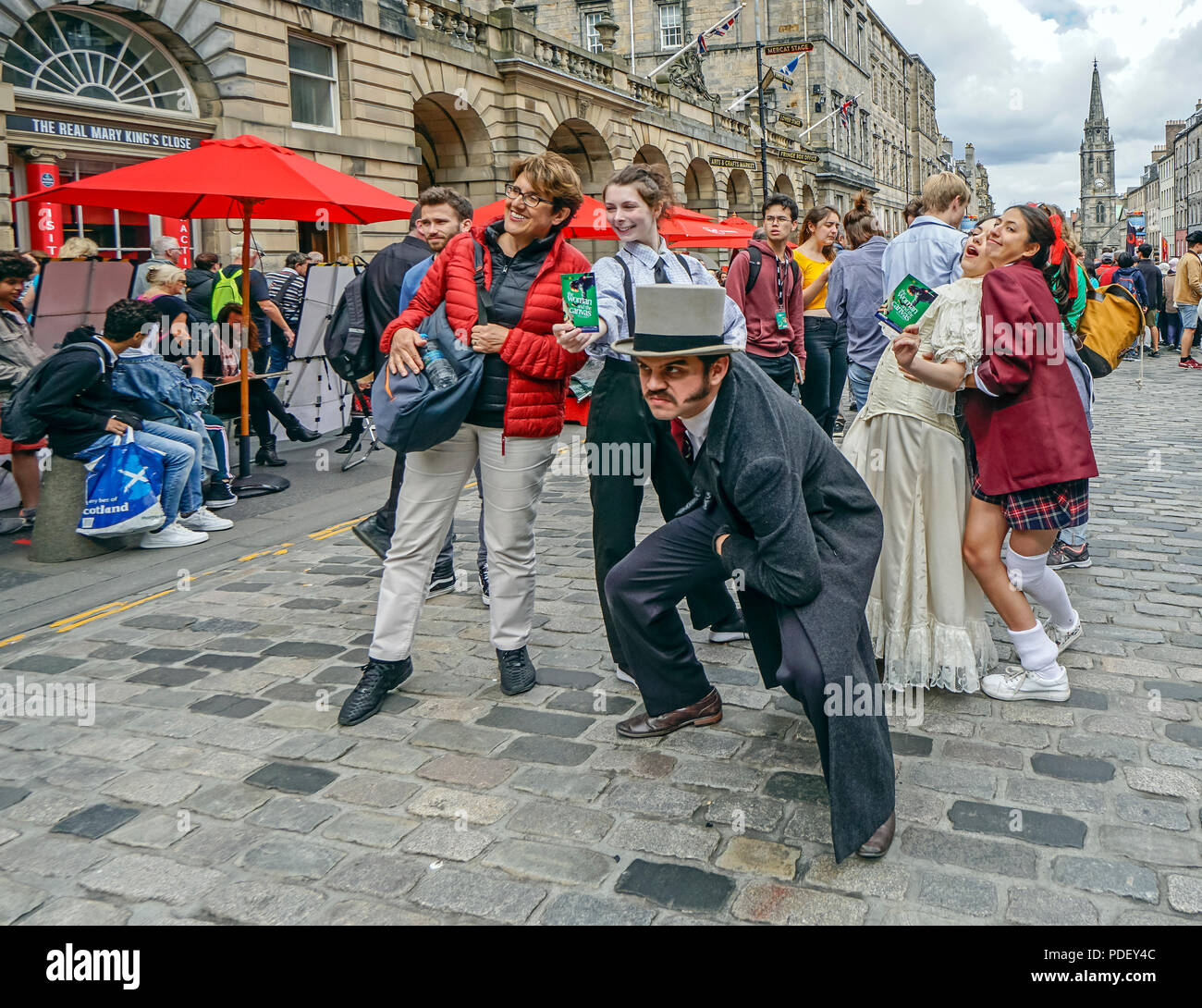 The Woman and the Canvas group performs at The Edinburgh Festival Fringe 2018 in High Street The Royal Mile Edinburgh Scotland UK - Stock Image