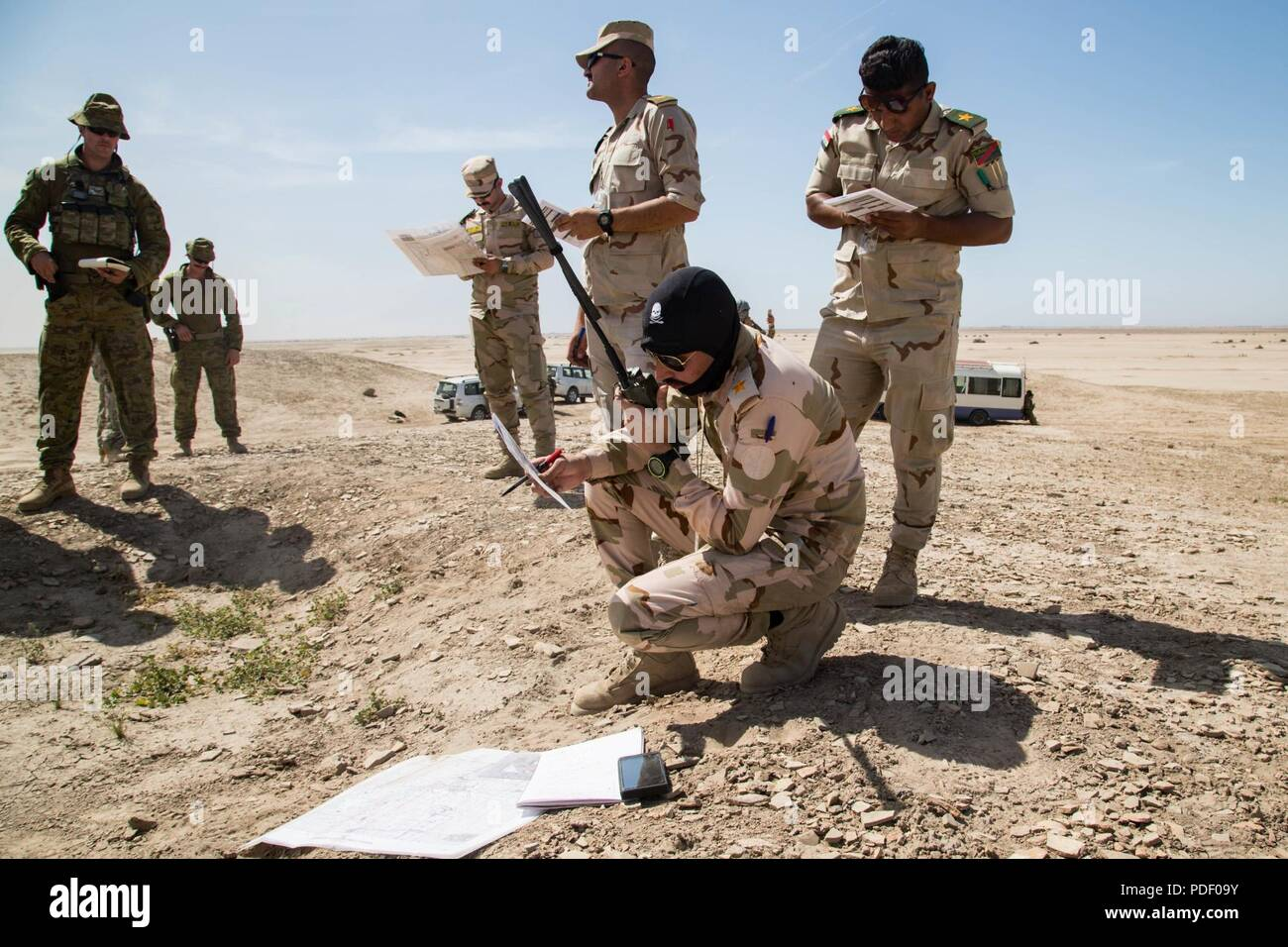 An Australian Army Instructor Observes Iraqi Soldiers As They Conduct A Situation Report During Training Scenario With The Forward Air Controller