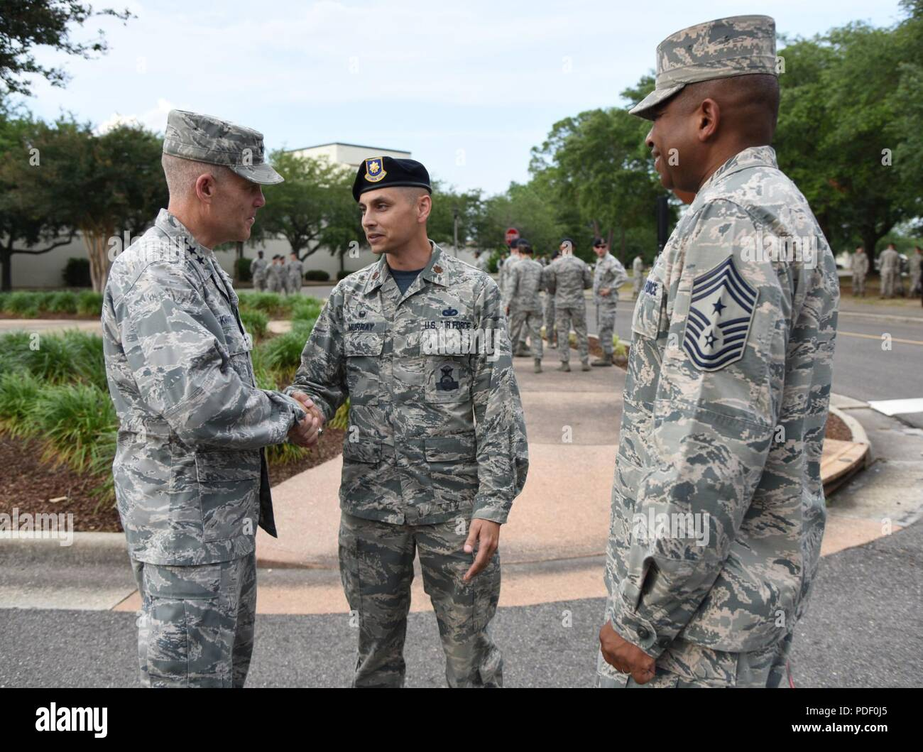 U S Air Force Maj Jonathon Murray 81st Security Forces Squadron Commander Greets Lt Gen Steve Kwast Commander Of Air Education And Training Command As Chief Master Sgt Farrell Thomas 2nd Air