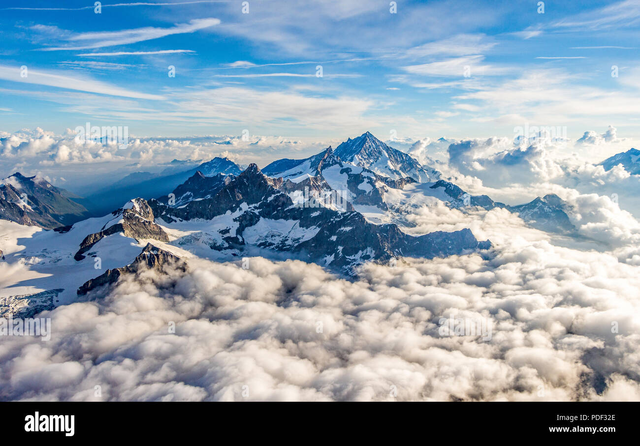 A stunning and dramatic view of the Weisshorn above the clouds as seen from the Matterhorn - Stock Image