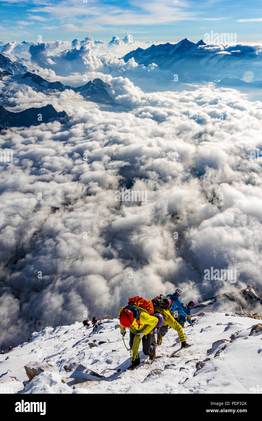 Mountaineers Ascent To The Summit Of The Matterhorn In Switzerland