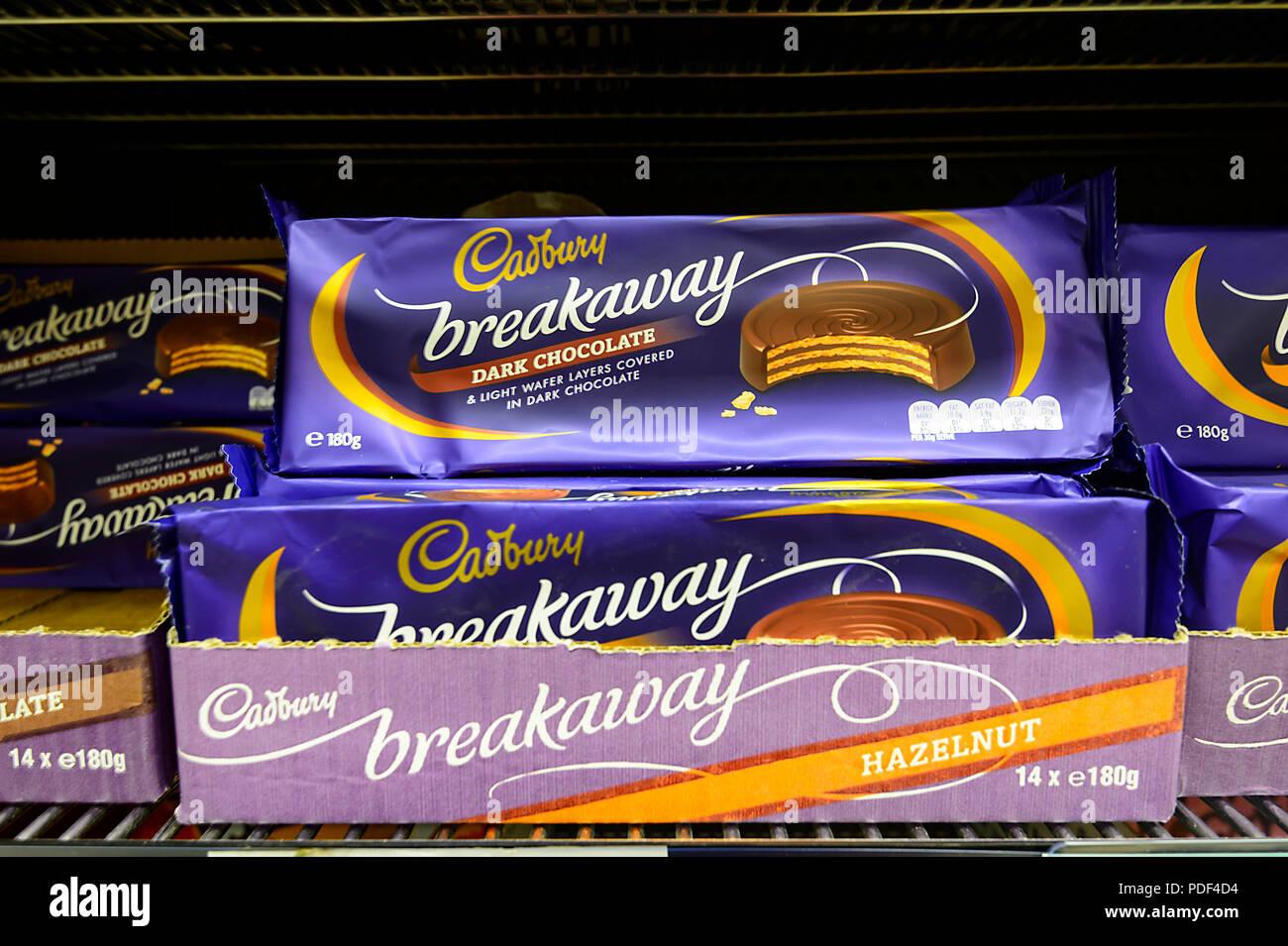 Bars of Cadbury breakaway chocolate on a shelf - Stock Image
