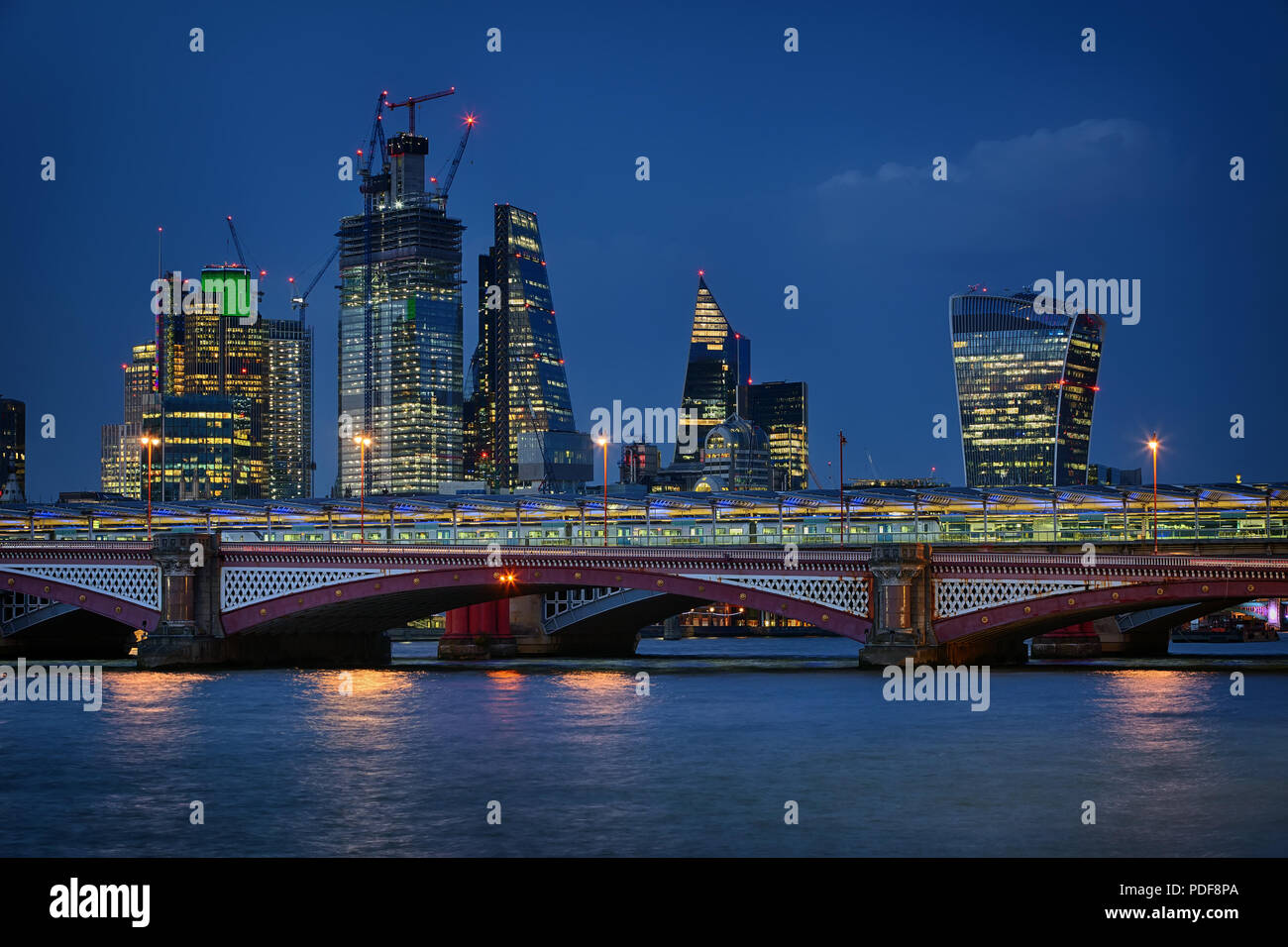 Blackfriars Bridge and the City of London at night in August 2018 - Stock Image
