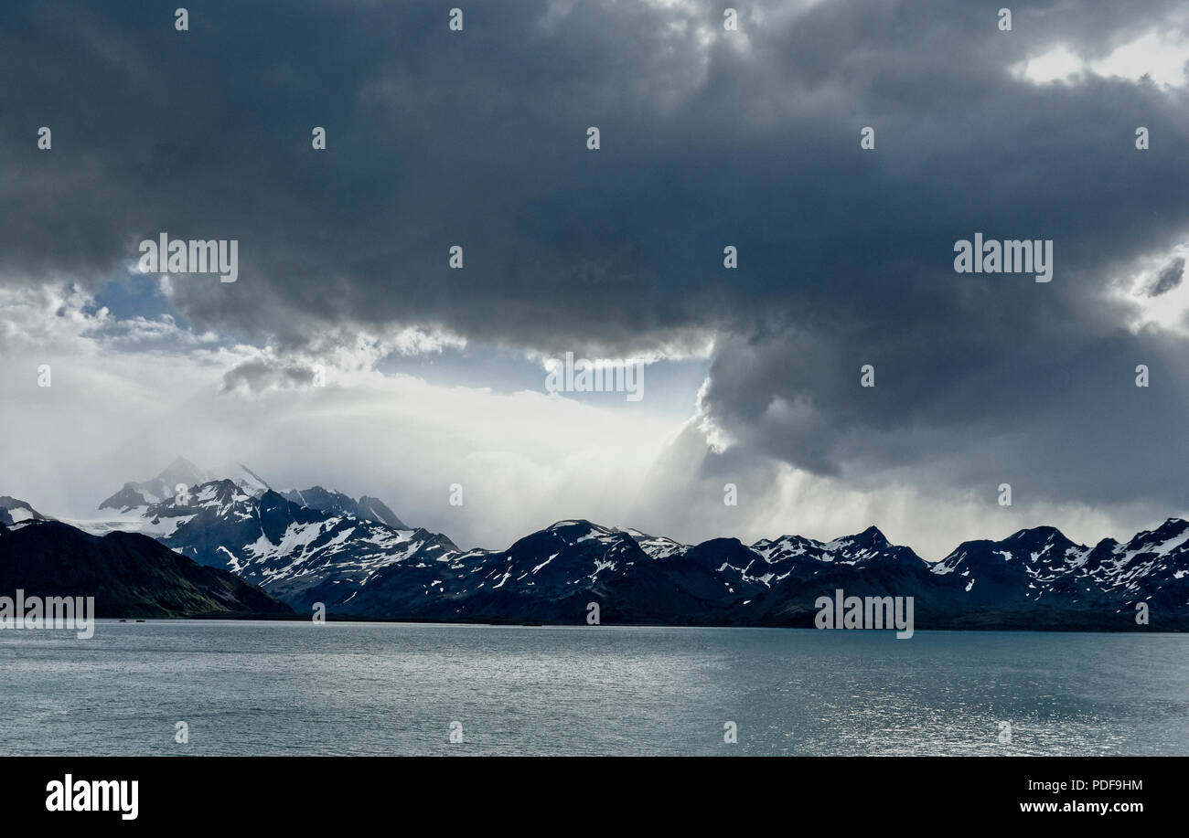 Storm clouds massing over the mountains of South Georgia Antartica Stock Photo