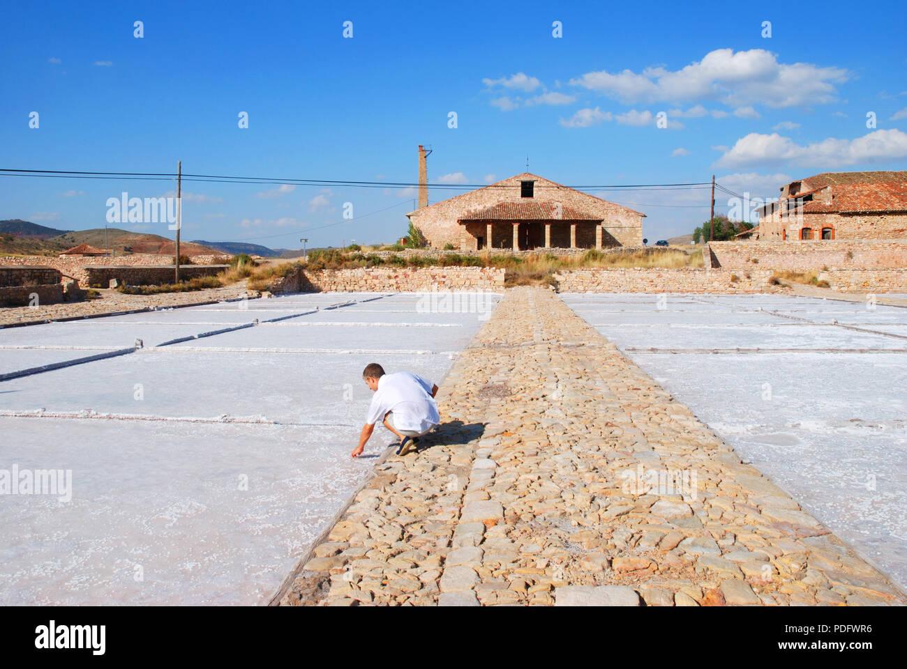 Man working at the saltworks. Imon, Guadalajara province, Castilla La Mancha, Spain. - Stock Image