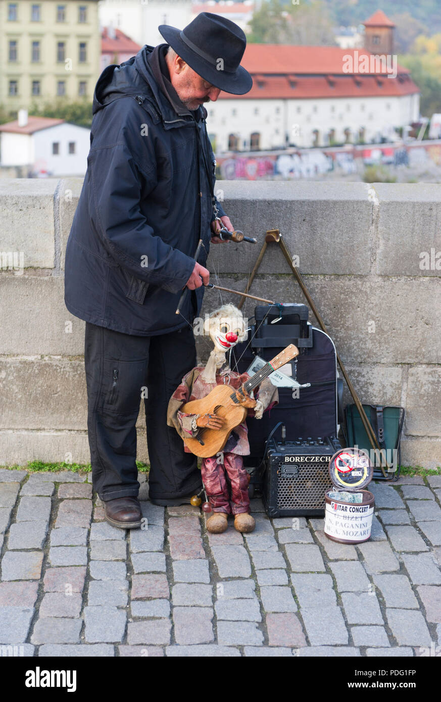 Street Puppeteer entertaining people on the Charles Brigde, Prague Czech Republic - Stock Image