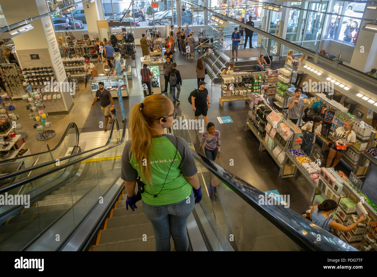 666495247 A Nordstrom Rack off-price store employee on the escalator in the Herald  Square New