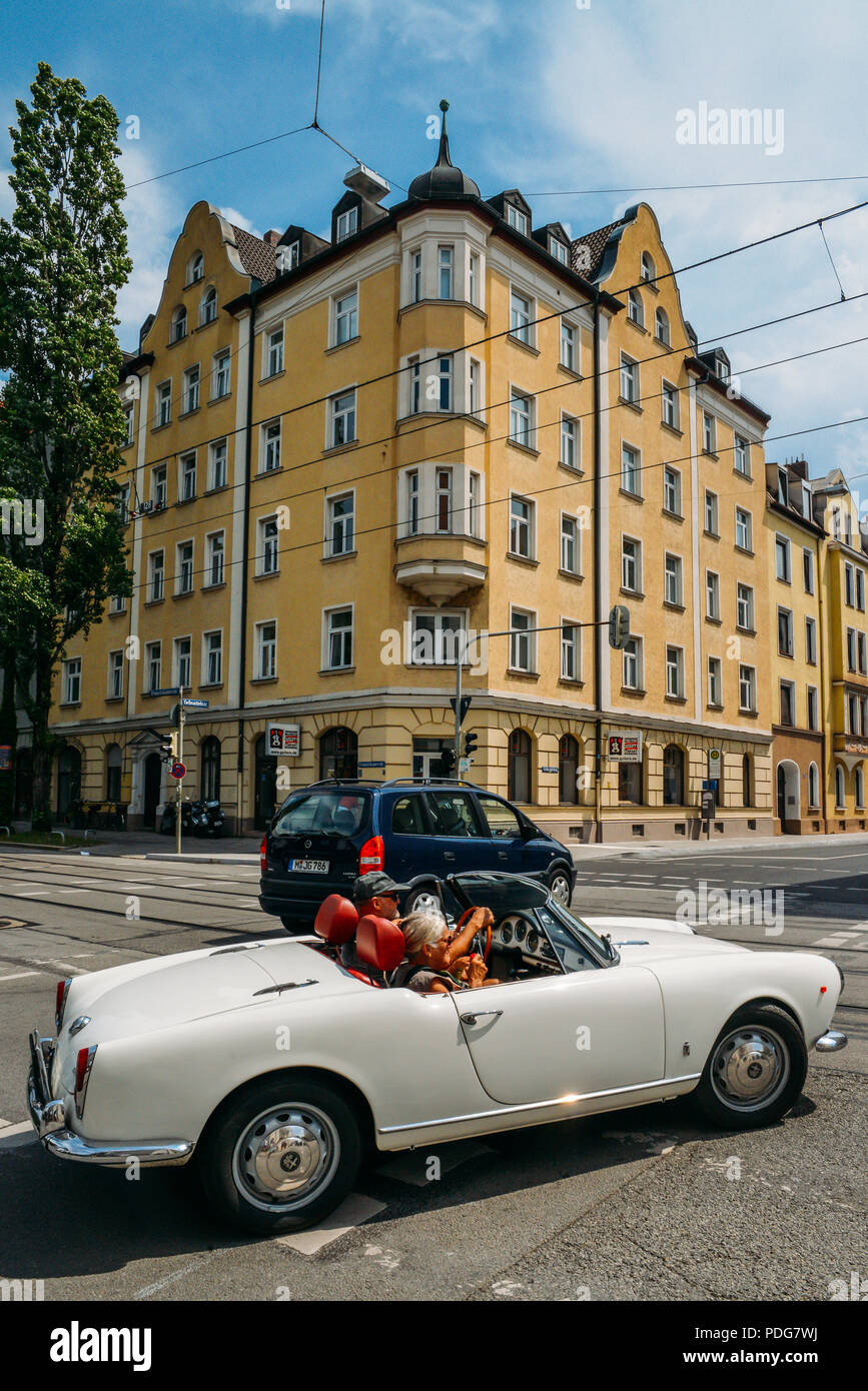Munich, Germany - July 28, 2018: Vintage car and vintage architecture in Munich, Germany - Stock Image