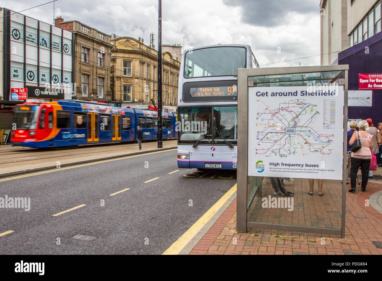 Bus, bus stop, trams in Sheffield city centre, UK - Stock Image