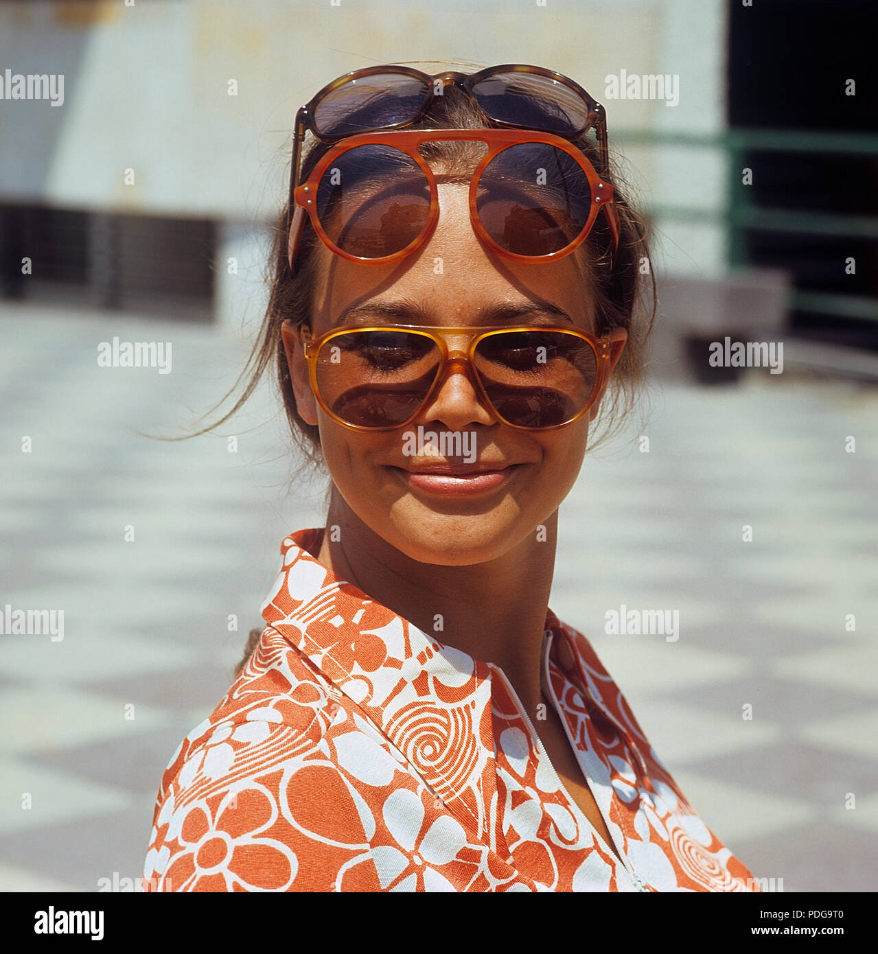 1960s glasses. Summer of 69. The young female fashion model is wearing this years models of sunglasses and accessories. 1969 ref CV25-12 - Stock Image
