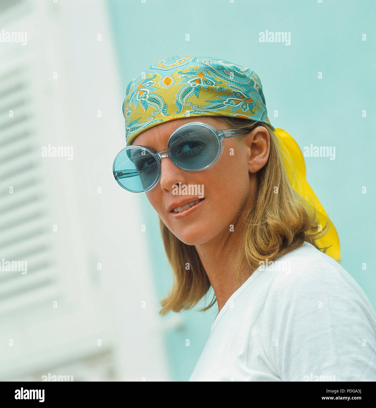 1960s glasses. Summer of 69. The young female fashion model is wearing this years model of sunglasses and accessories. 1969 ref CV25-8 - Stock Image