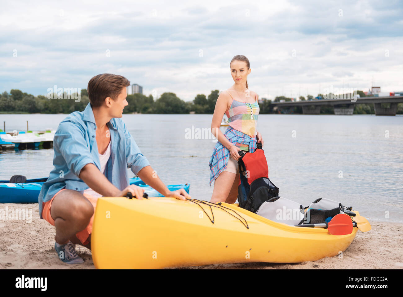 Cute coupe enjoying active tourism together Blonde-haired - Stock Image