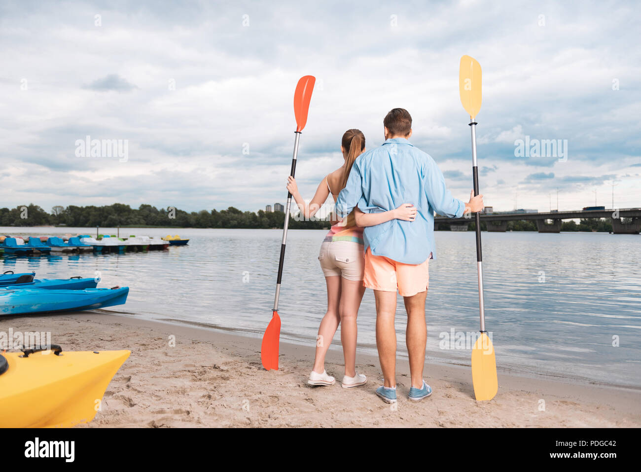 Young couple spending their leisure time near the waterway - Stock Image