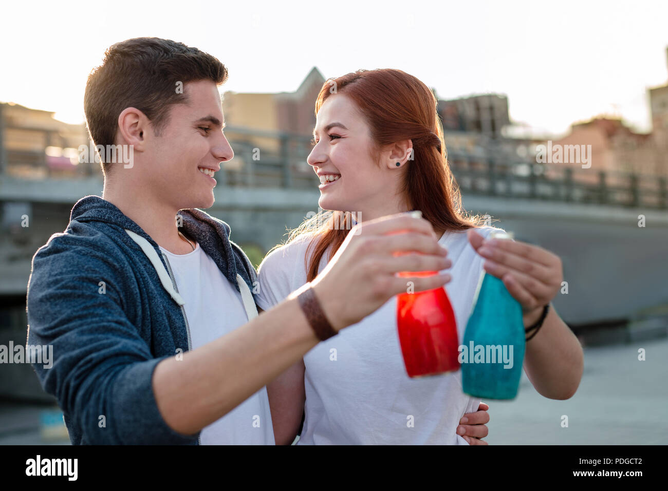 Happy positive couple drinking juice So delicious. - Stock Image