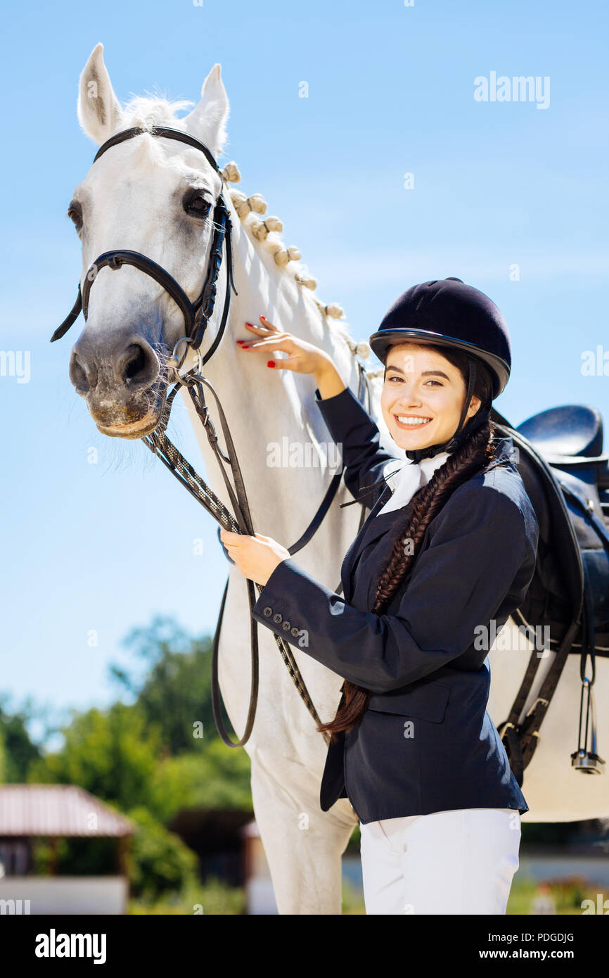 Businesswoman fond of equestrianism coming to race track - Stock Image