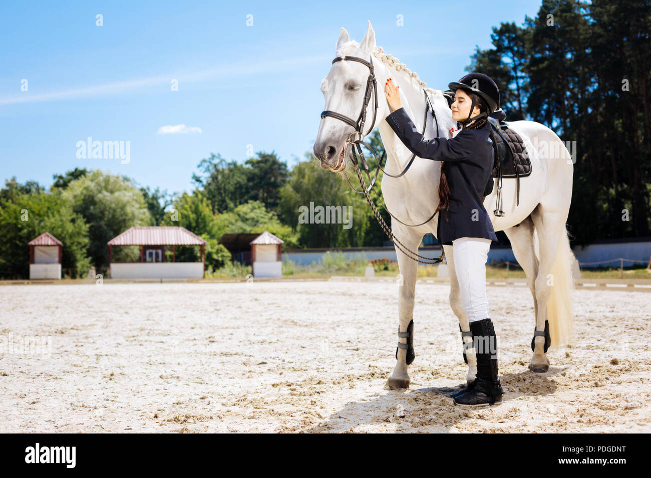 Female rider wearing white trousers and riding boots - Stock Image
