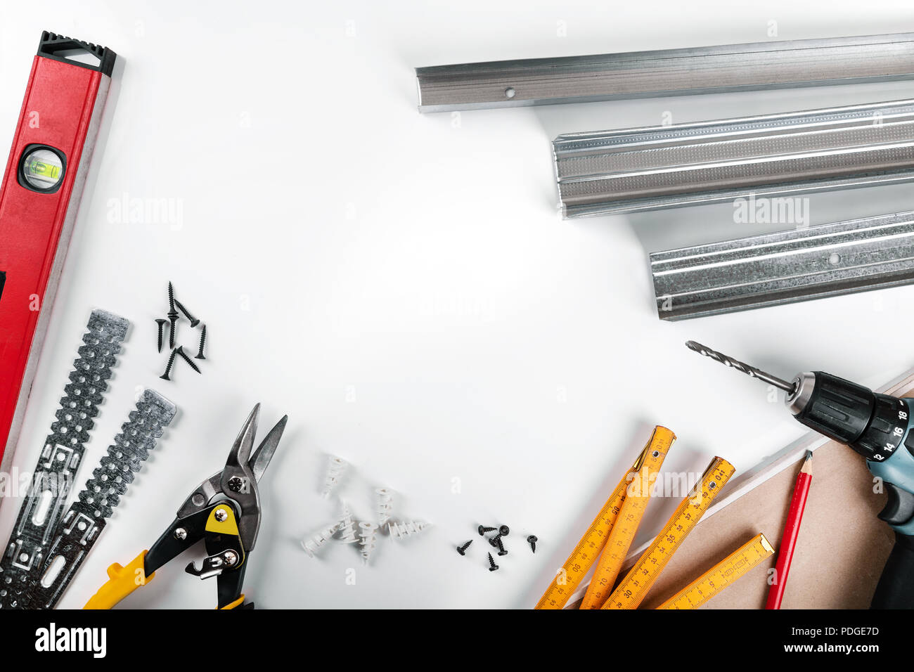 drywall mounting tools and fasteners on white background. top view - Stock Image