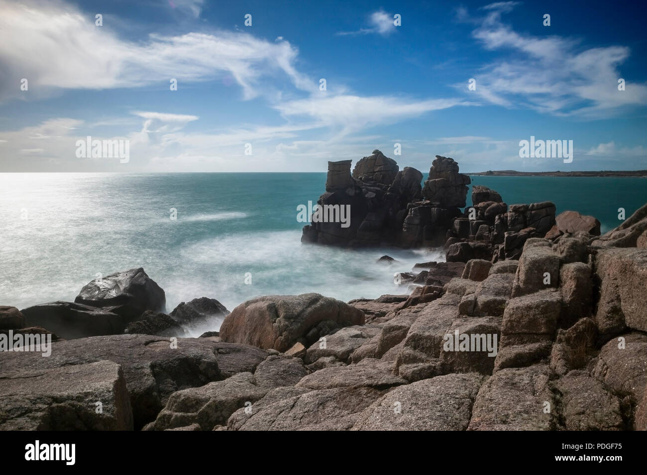 The rock formation known as The Chair, Peninnis Head, St. Mary's, Isles of Scilly, UK: ND filter gives a blurred effect tothe sea and sky - Stock Image