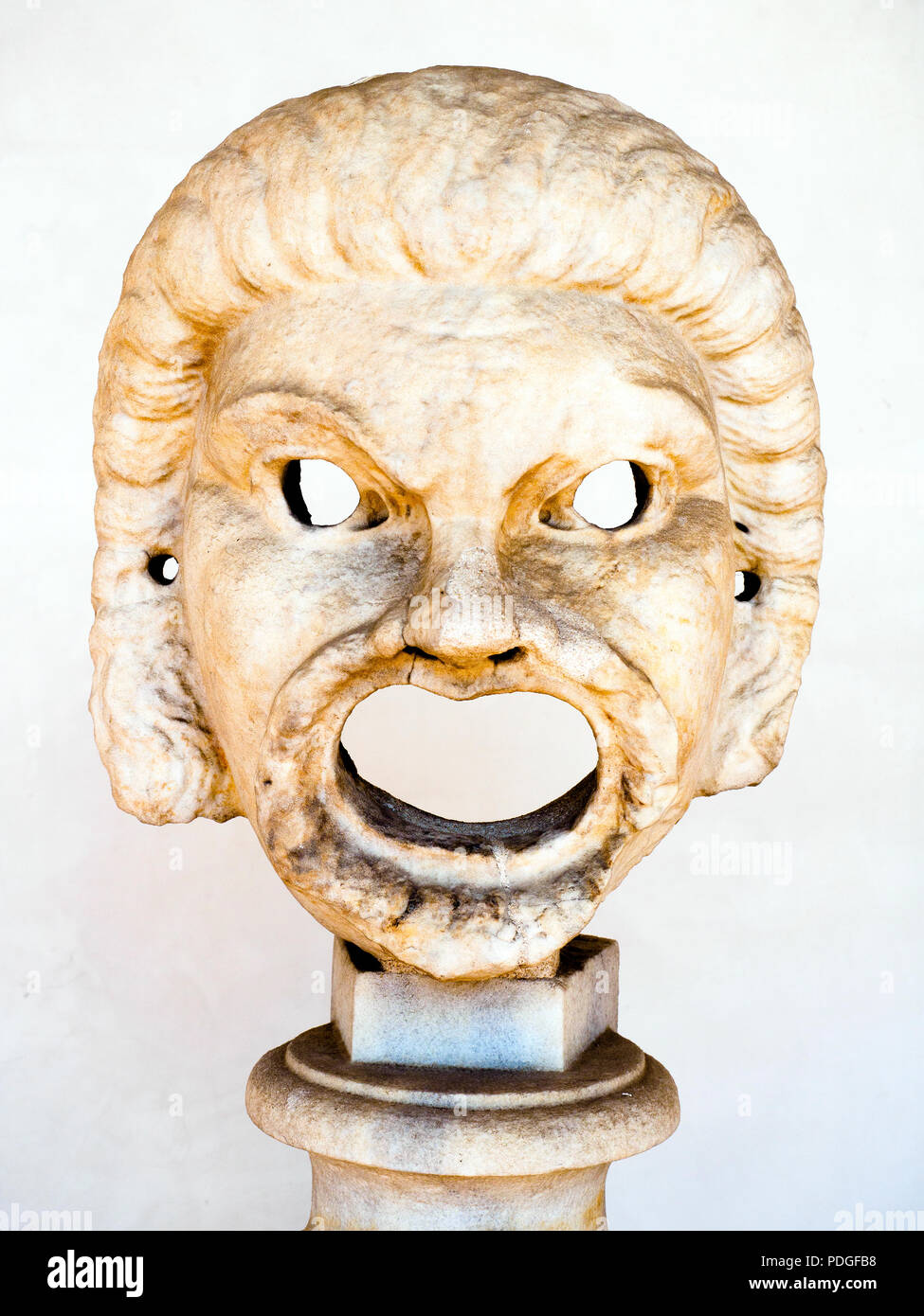 Male comic mask in white marble 2nd Century AD unknown provenance - National Roman Museum - The Baths of Diocletian - Rome, Italy - Stock Image