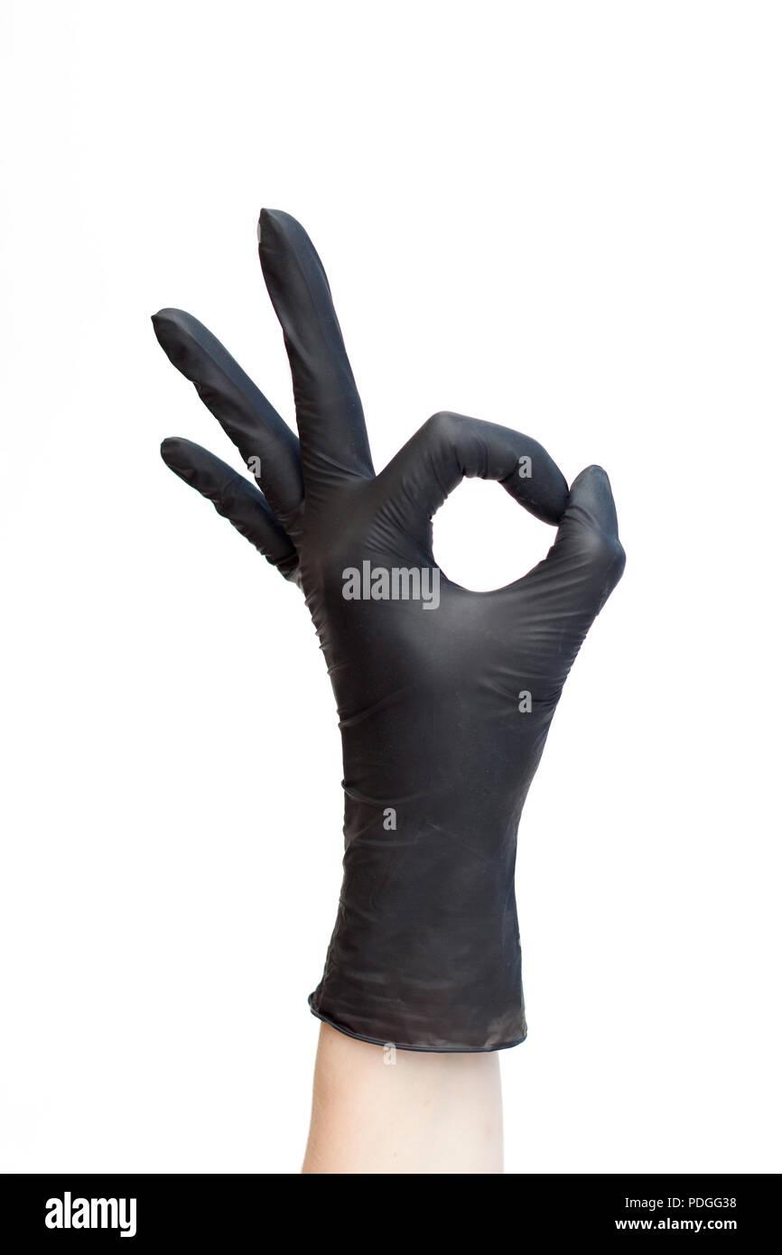 Ok Sign Made Of Black Medical Gloves Fingers Showing Okay Symbol