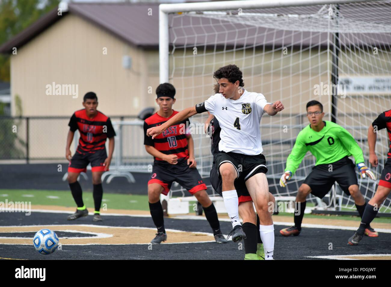 Player attempting to control a corner kick in front of the opposing goal, however, the ball was evetually cleared by the defense. USA. - Stock Image