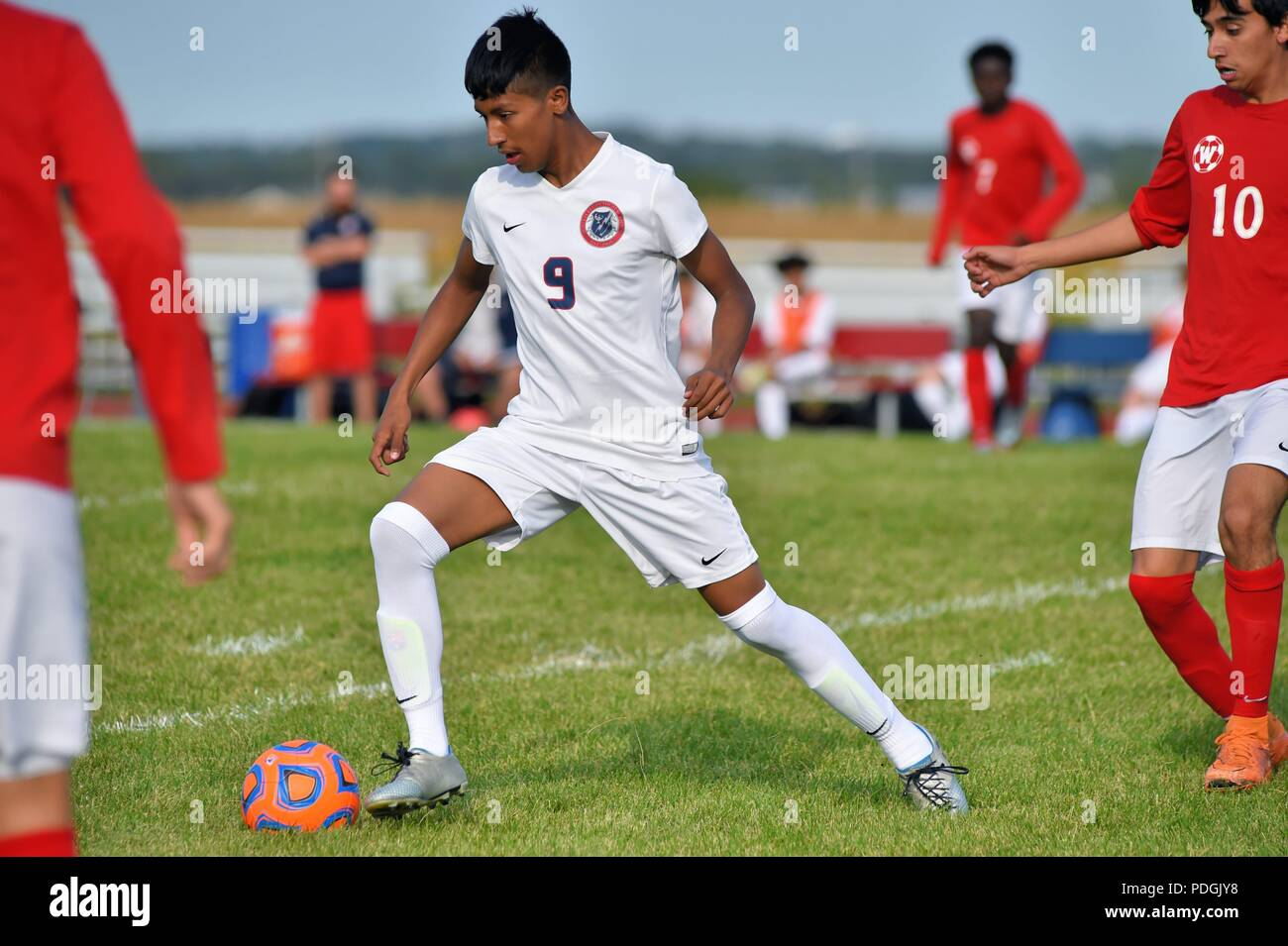 Player negotiating while in possession of the ball deep in the opponent's end of the pitch. USA. - Stock Image