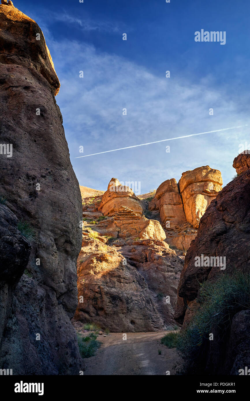 Orange rocks and road at Charyn canyon at sunset in Kazakhsthan Stock Photo